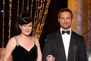 Actors Pauley Perrette (L) and Josh Holloway walk onstage during the 20th Annual Screen Actors Guild Awards at The Shrine Auditorium on January 18, 2014 in Los Angeles, California.