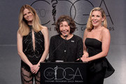 (L-R) Model Brooklyn Decker, actors Lily Tomlin and June Diane Raphael speak onstage during the Costume Designers Guild Awards at The Beverly Hilton Hotel on February 20, 2018 in Beverly Hills, California.
