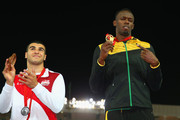 Silver medalist Adam Gemili of England and gold medalist Usain Bolt of Jamaica pose during the medal ceremony for the Men's 4x100 metres relay  at Hampden Park during day ten of the Glasgow 2014 Commonwealth Games on August 2, 2014 in Glasgow, United Kingdom.