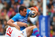 Mark Bright of England tackles Lee Jones of Scotland in the plate semi final match between Scotland and England during the Rugby Sevens at Ibrox Stadium during day four of the Glasgow 2014 Commonwealth Games on July 27, 2014 in Glasgow, United Kingdom.