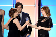 (L-R) Actress Rachel Bloom accepts the award for Best Actress in a Comedy Series for 'Crazy Ex-Girlfriend' from actors Thomas Middleditch and Carrie Brownstein onstage during the 21st Annual Critics' Choice Awards at Barker Hangar on January 17, 2016 in Santa Monica, California.