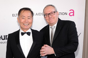 Actror George Takei and Brad Altman attend the 21st Annual Elton John AIDS Foundation Academy Awards Viewing Party at Pacific Design Center on February 24, 2013 in West Hollywood, California.