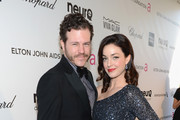 Mike Dolan (L) and actress Sadie Alexandru attend the 21st Annual Elton John AIDS Foundation Academy Awards Viewing Party at Pacific Design Center on February 24, 2013 in West Hollywood, California.