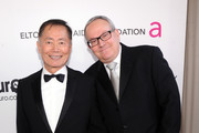 Actor George Takei and Brad Altman attend the 21st Annual Elton John AIDS Foundation Academy Awards Viewing Party at Pacific Design Center on February 24, 2013 in West Hollywood, California.