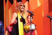 Bryce Dallas Howard accepts the Best Global Actress award onstage during the 21st Annual Huading Global Film Awards at The Theatre at Ace Hotel on December 15, 2016 in Los Angeles, California.