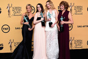 (L-R) Actresses Joanne Froggatt, Sophie McShera, Laura Carmichael, and Phyllis Logan, winners of Outstanding Performance by an Ensemble in a Drama Series for 'Downton Abbey,' pose in the press room at the 21st Annual Screen Actors Guild Awards at The Shrine Auditorium on January 25, 2015 in Los Angeles, California.