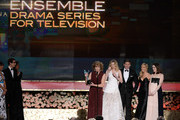 (L-R) Actors Phyllis Logan, Laura Carmichael, Allen Leech, Joanne Froggatt, and Sophie McShera accept the award for Outstanding Performance by an Ensemble in a Drama Series onstage from Andy Samberg and Rashida Jones (far left) at the 21st Annual Screen Actors Guild Awards at The Shrine Auditorium on January 25, 2015 in Los Angeles, California.