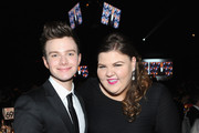 Actors Chris Colfer (L) and Ashley Fink attend the 22nd Annual Elton John AIDS Foundation Academy Awards Viewing Party at The City of West Hollywood Park on March 2, 2014 in West Hollywood, California.