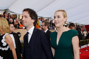 Actress Kate Winslet (R) and Ned Rocknroll attend the 22nd Annual Screen Actors Guild Awards at The Shrine Auditorium on January 30, 2016 in Los Angeles, California.
