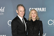 (L-R) Bo Welch and Catherine O'Hara attend the 22nd CDGA (Costume Designers Guild Awards) at The Beverly Hilton Hotel on January 28, 2020 in Beverly Hills, California.