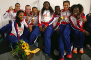 (L to R) Adam Gemili, Ashleigh Nelson, Richard Kilty, James Ellington, Asha Phillip, Harry Aikines-Aryeetey, Jodie Williams and Desiree Henry of Great Britain pictured after winning Gold in the Mens and Womens 4x100m relay during day six of the 22nd European Athletics Championships at Stadium Letzigrund on August 17, 2014 in Zurich, Switzerland.