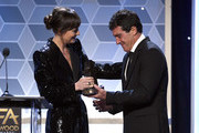 Antonio Banderas (R) accepts the Hollywood Actor Award from Dakota Johnson onstage during the 23rd Annual Hollywood Film Awards at The Beverly Hilton Hotel on November 03, 2019 in Beverly Hills, California.