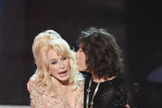 Actor Lily Tomlin (R) accepts the 2016 SAG Life Achievement Award from actor/singer Dolly Parton onstage during the 23rd Annual Screen Actors Guild Awards show at The Shrine Auditorium on January 29, 2017 in Los Angeles, California. / AFP / Robyn BECK