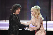 Actor Lily Tomlin accepts the 2016 SAG Life Achievement Award from actor/singer Dolly Parton onstage during the 23rd Annual Screen Actors Guild Awards show at The Shrine Auditorium on January 29, 2017 in Los Angeles, California. / AFP / Robyn BECK