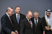(From L) Turkey's President Recep Tayyip Erdogan, Azerbaijan's President Ilham Aliyev, Russia's President Vladimir Putin, and Turkey's Prime Minister Binali Yildirim attend the 23rd World Energy Congress on October 10, 2016 in Istanbul..Russian President Vladimir Putin visits Turkey on October 10 for talks with counterpart Recep Tayyip Erdogan, pushing forward ambitious joint energy projects as the two sides try to overcome a crisis in ties.. / AFP / OZAN KOSE
