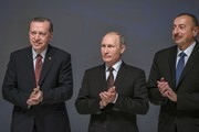 (From L) Turkey's President Recep Tayyip Erdogan, Russia's President Vladimir Putin and Azerbaijan's President Ilham Aliyev applaud during the 23rd World Energy Congress on October 10, 2016 in Istanbul..Putin visits Turkey on October 10 for talks with counterpart Recep Tayyip Erdogan, pushing forward ambitious joint energy projects as the two sides try to overcome a crisis in ties.. / AFP / OZAN KOSE