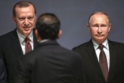 Russian President Vladimir Putin (R) and Turkish President Recep Tayyip Erdogan (L) attend the 23rd World Energy Congress on October 10, 2016 in Istanbul..Putin visits Turkey on October 10 for talks with counterpart Recep Tayyip Erdogan, pushing forward ambitious joint energy projects as the two sides try to overcome a crisis in ties.. / AFP / OZAN KOSE