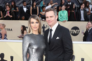 Actor Natalie Zea (L) and Travis Schuldt attend the 24th Annual Screen Actors Guild Awards at The Shrine Auditorium on January 21, 2018 in Los Angeles, California. 27522_017