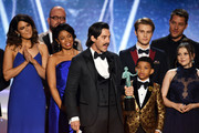 Actor Milo Ventimiglia (C, holding award trophy) and 'This Is Us' castmates accept the Outstanding Performance by an Ensemble in a Drama Series award onstage during the 24th Annual Screen Actors Guild Awards at The Shrine Auditorium on January 21, 2018 in Los Angeles, California. 27522_013