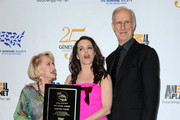(L-R)  Actress Tippi Hedren with Kristin Davis and james Cromwell, actor pose in the press room at the 25th Anniversary Genesis Awards held at the Hyatt Regency Century Plaza Hotel on March 19, 2011 in Los Angeles, California.