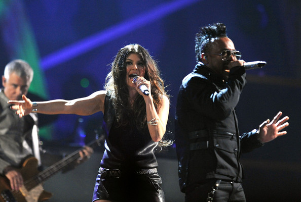 Fergie of Apl.de.Ap of Black Eyed Peas perform onstage with U2 at the 25th Anniversary Rock & Roll Hall of Fame Concert at Madison Square Garden on October 30, 2009 in New York City.