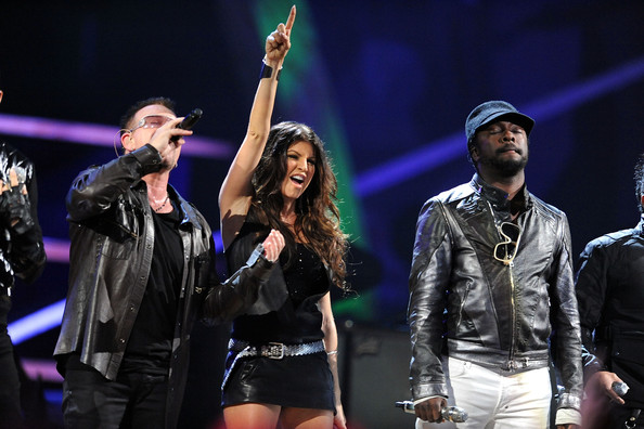 Bono of U2, Fergie and will.i.am of Black Eyed Peas perform onstage at the 25th Anniversary Rock & Roll Hall of Fame Concert at Madison Square Garden on October 30, 2009 in New York City.