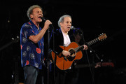 Art Garfunkel and Paul Simon perform onstage at the 25th Anniversary Rock & Roll Hall of Fame Concert at Madison Square Garden on October 29, 2009 in New York City.