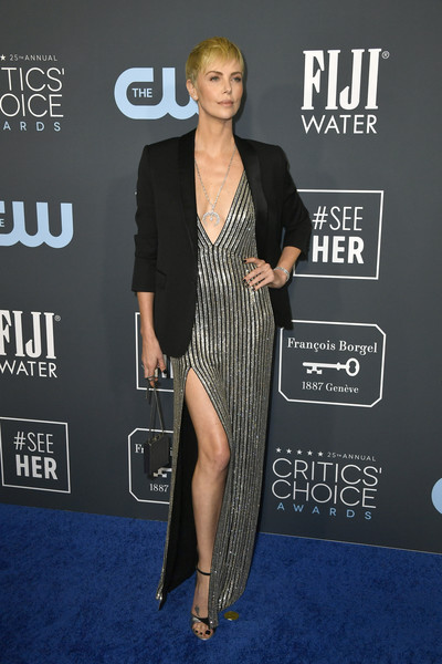 Charlize Theron tempered the sexiness with a black blazer, also by Celine.