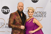 Chris Sullivan (L) and Rachel Reichard arrive at the 25th Annual Screen ActorsGuild Awards at the The Shrine Auditorium on January 27, 2019 in Los Angeles, California.