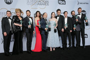"(L-R) Joel Johnstone, Caroline Aaron, Michael Zegen, Marin Hinkle, Kevin Pollak, Rachel Brosnahan, Luke Kirby, Brian Tarantina, Tony Shalhoub, and Zachary Levi pose in the press room with awards for Outstanding Performance by an Ensemble in a Comedy Series in ""The Marvelous Mrs. Maisel,"" pose in the press room at the 25th annual Screen Actors Guild Awards at The Shrine Auditorium on January 27, 2019 in Los Angeles, California."