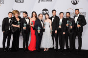 (L-R) Joel Johnstone, Caroline Aaron, Michael Zegen, Marin Hinkle, Kevin Pollak, Rachel Brosnahan, Luke Kirby, Brian Tarantina, Tony Shalhoub, and Zachary Levi, winners of Outstanding Performance by an Ensemble in a Comedy Series for 'The Marvelous Mrs. Maisel,' attend the 25th Annual Screen ActorsGuild Awards at The Shrine Auditorium on January 27, 2019 in Los Angeles, California.