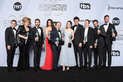 (L-R) Joel Johnstone, Caroline Aaron, Michael Zegen, Marin Hinkle, Kevin Pollak, Rachel Brosnahan, Luke Kirby, Brian Tarantina, Tony Shalhoub, and Zachary Levi pose in the press room with awards for Outstanding Performance by an Ensemble in a Comedy Series in 'The Marvelous Mrs. Maisel' during the 25th Annual Screen ActorsGuild Awards at The Shrine Auditorium on January 27, 2019 in Los Angeles, California. 480645