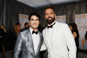 (L-R) Darren Criss and Ricky Martin attend the 25th Annual Screen Actors Guild Awards at The Shrine Auditorium on January 27, 2019 in Los Angeles, California.