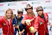 Recording artist Bucky Covington (L) Chris Lucas (2 L) and Preston Brust (4R) of musical duo LoCash, and singer-songwriter Bret Michaels (3R) attend the 26th Annual City of Hope Celebrity Softball Game at First Tennessee Park on June 7, 2016 in Nashville, Tennessee.