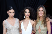 (L-R) Adriana Lima, Shanina Shaik, and  Heidi Klum attends the 26th annual Elton John AIDS Foundation Academy Awards Viewing Party sponsored by Bulgari, celebrating EJAF and the 90th Academy Awards at The City of West Hollywood Park on March 4, 2018 in West Hollywood, California.