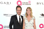 Eric McCormack (L) Janet Holden attend the 26th annual Elton John AIDS Foundation's Academy Awards Viewing Party at The City of West Hollywood Park on March 4, 2018 in West Hollywood, California.