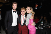 (L-R) Liam Hemsworth, Sir Elton John and Miley Cyrus attend the 26th annual Elton John AIDS Foundation Academy Awards Viewing Party with cocktails by Clase Azul Tequila at The City of West Hollywood Park on March 4, 2018 in West Hollywood, California.