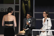 (L-R) Phoebe Waller-Bridge accepts Outstanding Female Actor in a Comedy Series for 'Fleabag' from Jharrel Jerome and Millie Bobby Brown onstage at the 26th Annual Screen ActorsGuild Awards at The Shrine Auditorium on January 19, 2020 in Los Angeles, California. 721359