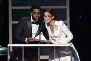 (L-R) Jharrel Jerome and Millie Bobby Brown speak onstage during the 26th Annual Screen ActorsGuild Awards at The Shrine Auditorium on January 19, 2020 in Los Angeles, California. 721359
