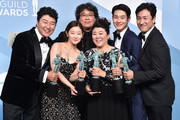 """""""Parasite"""" cast Song Kang-ho, Cho Yeo-jeong, director Bong Joon-ho, Lee Jung-eun, Choi Woo-shik, and Lee Sun-kyun pose in the press room with the trophy for Outstanding Performance by a Cast in a Motion Picture during the 26th Annual Screen ActorsGuild Awards at The Shrine Auditorium on January 19, 2020 in Los Angeles, California. 721430"""