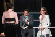 (L-R) Jharrel Jerome and Millie Bobby Brown present  Phoebe Waller-Bridge with the award for Female actor in a Comedy Series onstage during the 26th Annual Screen Actors Guild Awards at The Shrine Auditorium on January 19, 2020 in Los Angeles, California.