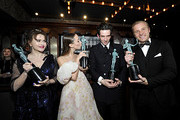 (L-R) Helena Bonham Carter, Erin Doherty, Josh O'Connor and Sam Phillips, winners of Outstanding Performance by an Ensemble in a Drama Series pose in the trophy room during the 26th Annual Screen Actors Guild Awards at The Shrine Auditorium on January 19, 2020 in Los Angeles, California. 721453