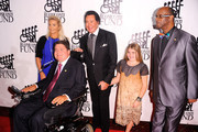 Kathleen McCrone, Marc Buoniconti, and Wayne Newton and Bob Beamon attend the 26th Annual Great Sports Legends Dinner to benefit the Buoniconti Fund To Cure Paralysis at The Waldorf=Astoria on September 26, 2011 in New York City.