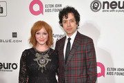 Christina Hendricks and Geoffrey Arend attend the 27th annual Elton John AIDS Foundation Academy Awards Viewing Party celebrating EJAF and the 91st Academy Awards on February 24, 2019 in West Hollywood, California.