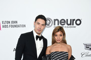 Lewis Tan (L) and Rola attend the 27th annual Elton John AIDS Foundation Academy Awards Viewing Party sponsored by IMDb and Neuro Drinks celebrating EJAF and the 91st Academy Awards on February 24, 2019 in West Hollywood, California.