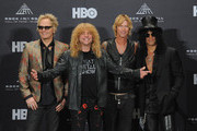 Inductees (L-R) Matt Sorum, Steven Adler, Duff McKagan and Slash of Guns N? Roses pose in the press room during the 27th Annual Rock And Roll Hall of Fame Induction Ceremony at Public Hall on April 14, 2012 in Cleveland, Ohio.