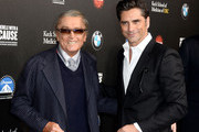 Producer Robert Evans and actor John Stamos  arrive at the 2nd Annual Rebels With A Cause Gala at Paramount Studios on March 20, 2014 in Hollywood, California.