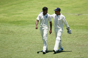 India captain MS Dhoni talks to team mate Varun Aaron during day three of the 2nd Test match between Australia and India at The Gabba on December 19, 2014 in Brisbane, Australia.