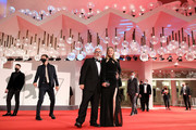 """Carolina Bang and Director Álex de la Iglesia walk the red carpet ahead of the movie """"30 Monedas"""" (30 Coins) - Episode 1 at the 77th Venice Film Festival on September 11, 2020 in Venice, Italy."""
