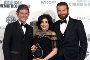 (L-R) CEO of Hill Valley Eric Nebot, honoree Sue Kroll and actor Bradley Cooper pose with the Sid Grauman Award  during the 30th Annual American Cinematheque Awards Gala at The Beverly Hilton Hotel on October 14, 2016 in Beverly Hills, California.